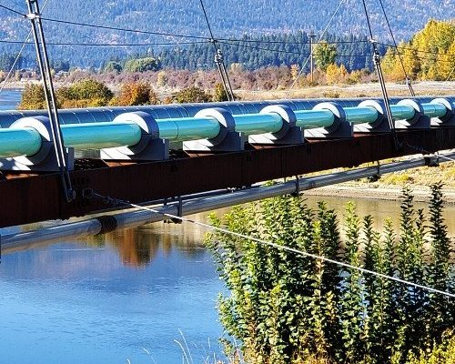 dragon jacket insulation insulated pipe saddles installed on sewer main suspension bridge in bonner's ferry, idaho